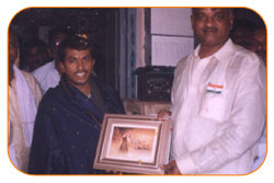 Mr. N Bitra Receiving A memento from Pinnamaneni Venkateswara Rao, Minister Technical Education, on the occasion of 56th Independence Day (15th August 2003). Bitra Net Pvt. Ltd., has donated two letest configuration computers to a School located in Puttagunta (Krishna Dist, Andhra Pradesh)